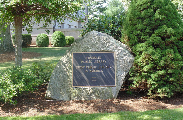 Franklin Public Library placard on a rock.